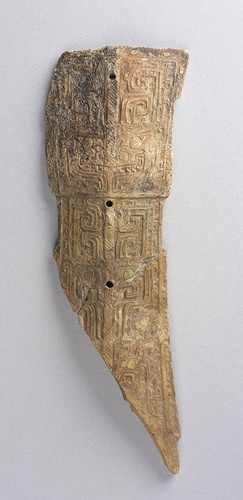 Whistle with carved animal-mask motifs